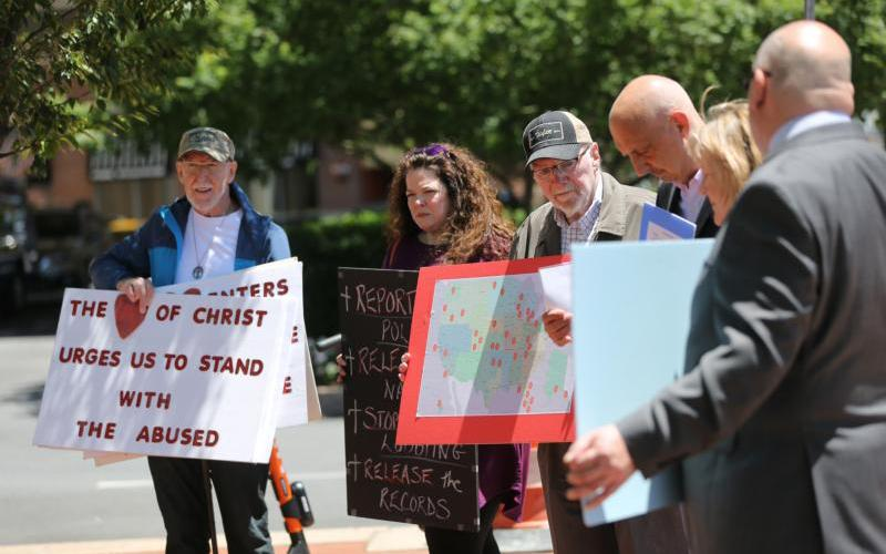 Survivors Network of those Abused by Priests and other groups gather outside a Baltimore hotel June 11, 2019, on the first day of the spring general assembly of the U.S. Conference of Catholic Bishops. (CNS photo by Bob Roller)