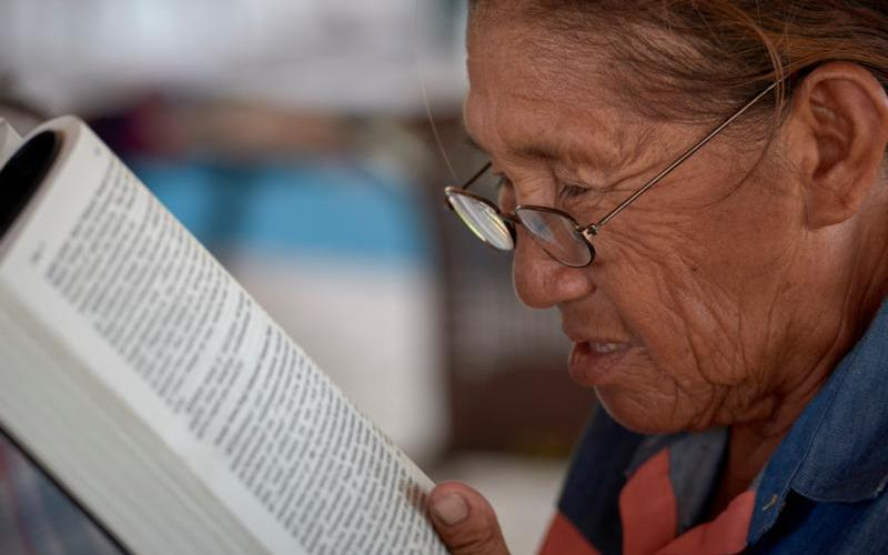 A woman reads the Bible during a workshop in St. Ignatius, Guyana, April 5, 2019. (CNS photo by Paul Jeffrey)