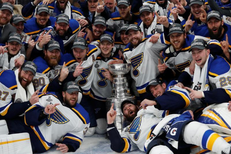 St. Louis Blues players pose for a team photo with the Stanley Cup. (CNS photo by Winslow Townson/USA TODAY Sports)