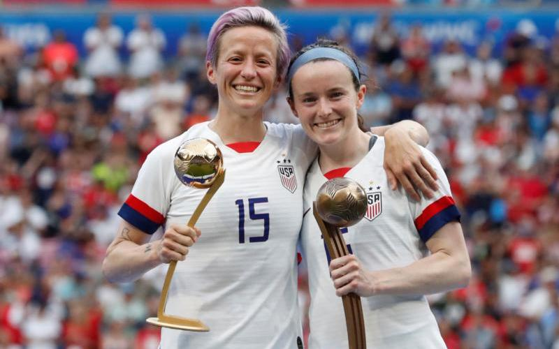 Megan Rapinoe and Rose Lavelle of the U.S. celebrate being awarded the golden ball and bronze ball after winning the FIFA Women's World Cup in Lyon, France, July 7, 2019. (CNS photo by Bernadett Szabo/Reuters)