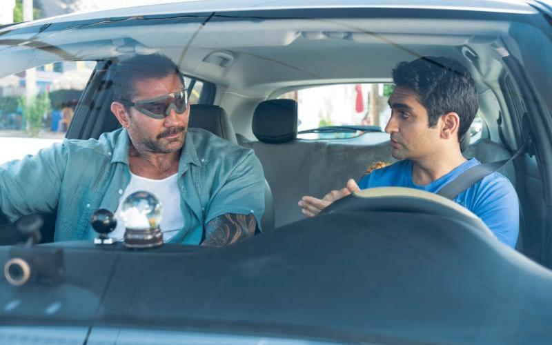 "Dave Bautista and Kumail Nanjiani star in a scene from the movie ""Stuber."" (CNS photo by Fox)"