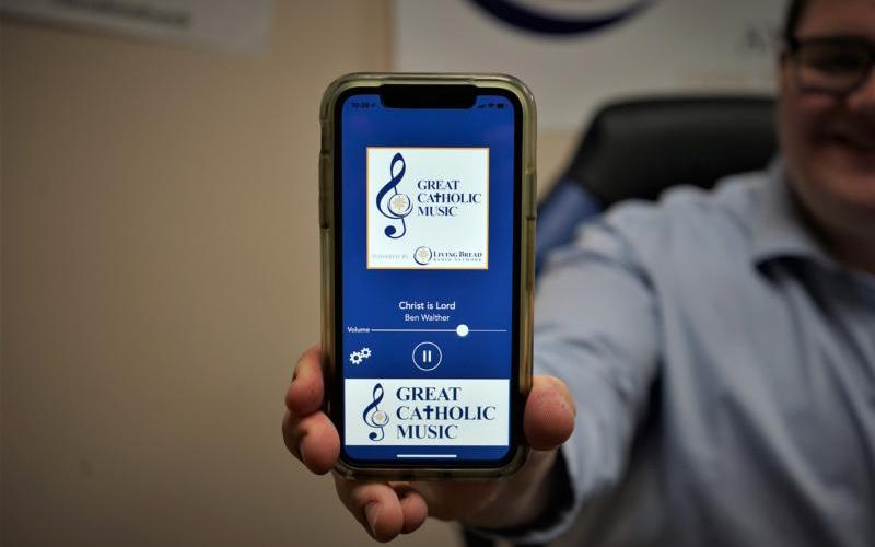 Program director Michael Roberts demonstrates the Great Catholic Music app for listeners. Great Catholic Music, an audio web streaming service, is a project of the Living Bread Radio Network, a group of Catholic radio stations in northeast Ohio. (CNS photo courtesy Chris Cugini/Living Bread Radio)