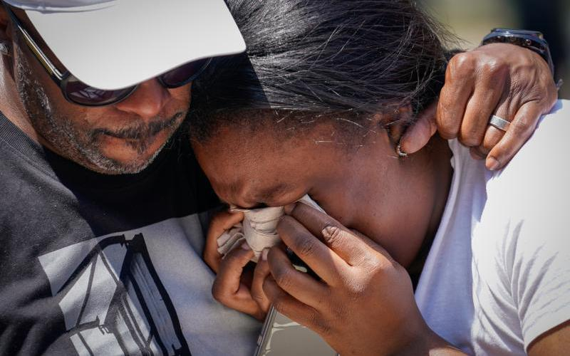 A woman becomes emotional during a vigil in Dayton, Ohio, Aug. 4, 2019. (CNS photo by Bryan Woolston/Reuters)