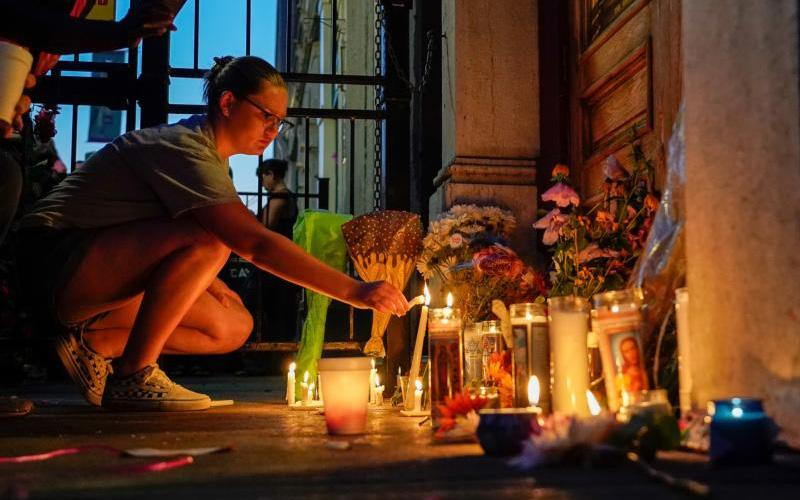A mourner leaves a candle at the scene of a shooting in Dayton, Ohio, Aug. 4, 2019. (CNS photo by Bryan Woolston/Reuters)