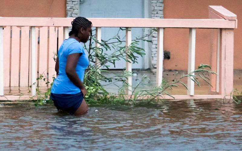 A woman walks in a flooded street in the aftermath of Hurricane Dorian in Nassau, Bahamas, Sept. 2, 2019.