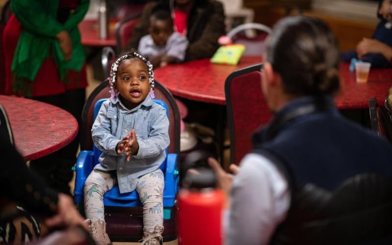 A child claps during the Lullaby Project Song Circle at Siena House in the Bronx section of New York City Dec. 17, 2018.