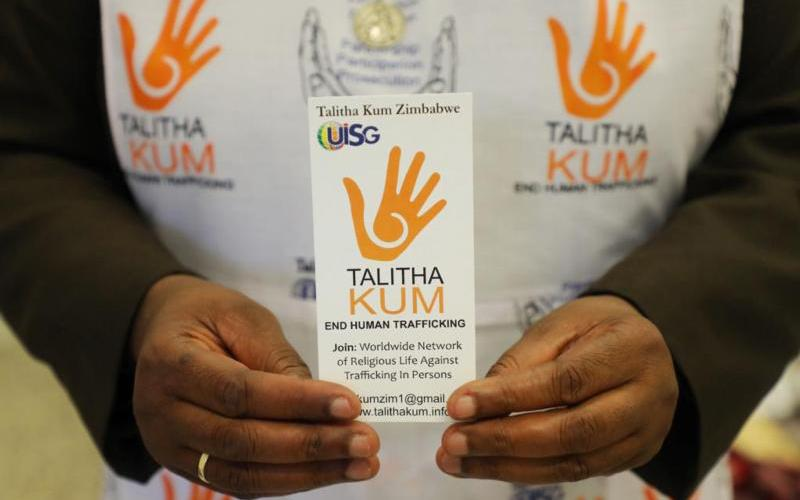 A card is displayed as women religious from around the world gather in Rome Sept. 21-27, 2019, to celebrate the 10th anniversary of Talitha Kum, an international network of religious women fighting against human trafficking.