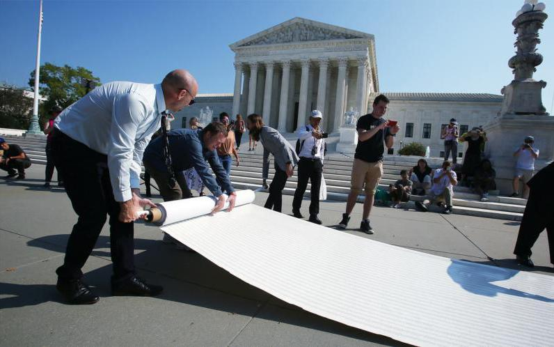 Pro-life leaders unfurl a petition in front of the U.S. Supreme Court in Washington Oct. 1, 2019, with more than 250,000 signatures calling for the court to overturn Roe v. Wade.
