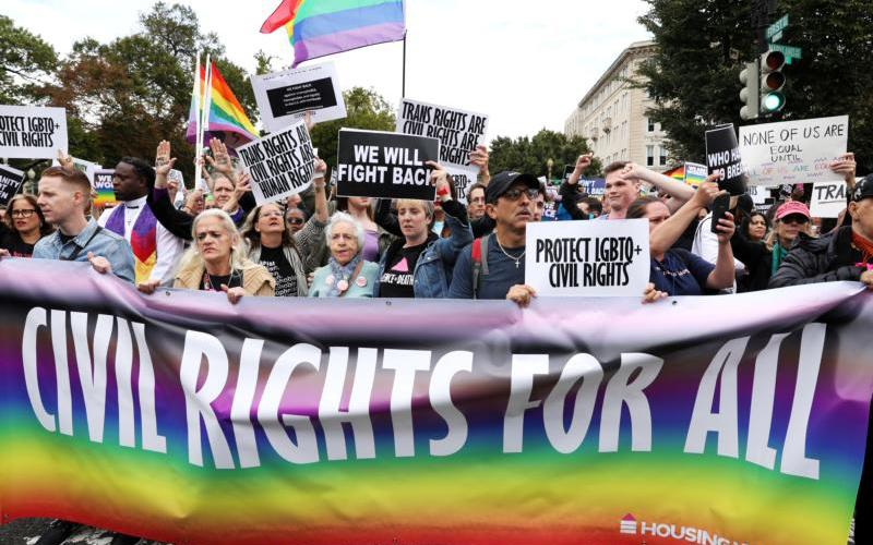 "Activists and supporters block the street outside the U.S. Supreme Court in Washington Oct. 8, 2019, as it hears arguments in three major employment discrimination cases on whether federal civil rights law prohibiting workplace discrimination on the ""basis of sex"" covers gay and transgender employees."