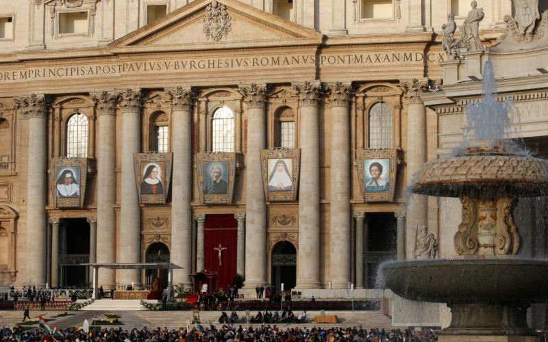 Banners showing five new saints are pictured on the facade of St. Peter's Basilica before a canonization Mass celebrated by Pope Francis in St. Peter's Square at the Vatican Oct. 13, 2019.