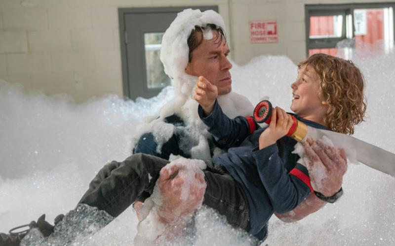 """John Cena and Christian Convery star in a scene from the movie """"Playing With Fire."""""""