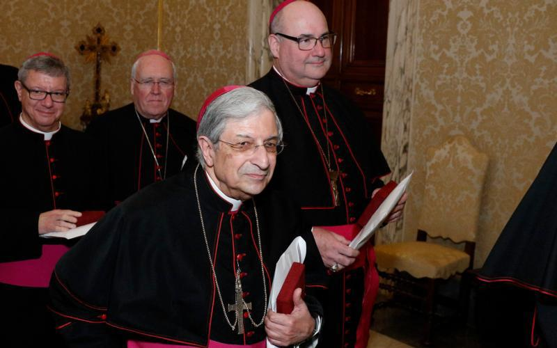 Bishop Salvatore R. Matano of Rochester and other U.S. bishops from the state of New York walk through the Apostolic Palace after meeting Pope Francis at the Vatican Nov. 15, 2019.