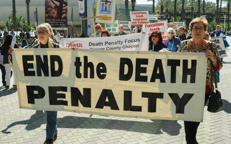 Demonstrators march to protest the death penalty during a rally organized by Catholics Against the Death Penalty-Southern California in Anaheim Feb. 25, 2017.