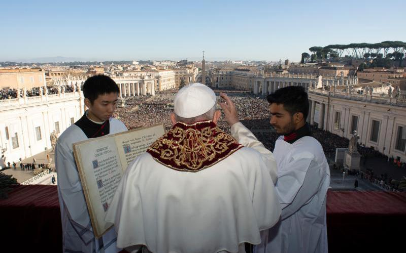 """Pope Francis delivers his Christmas blessing """"urbi et orbi"""" (to the city and the world) from the central balcony of St. Peter's Basilica at the Vatican Dec. 25, 2019."""