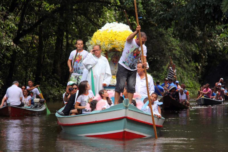 Pilgrims travel in boats as they accompany the statue of Our Lady of Nazareth during an annual river procession and pilgrimage along the Apeu River to a chapel in Macapazinho, Brazil, Aug. 3, 2014.