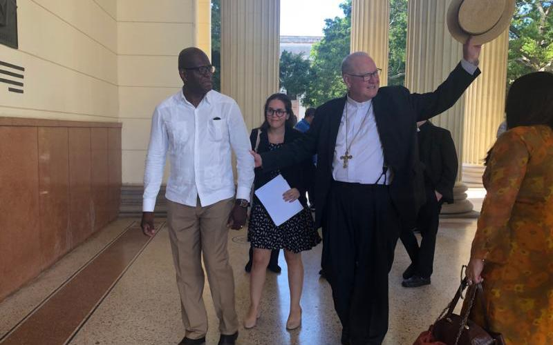 New York Cardinal Timothy M. Dolan stops for a quick tour of the University of Havana Feb. 11, 2020.