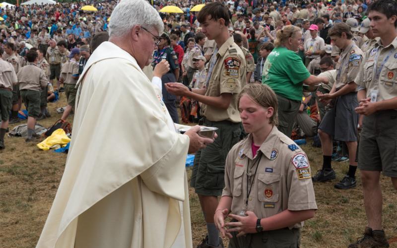 A Boy Scout receives holy Communion