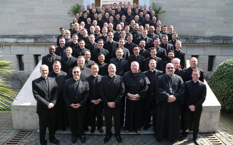 The staff and 92 seminarians at the Pontifical North American College in Rome pose for a photograph March 15, 2020, on the steps leading to the seminary chapel.