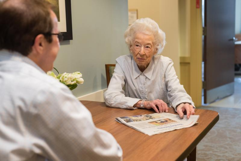 A resident of Mount Carmel Rehabilitation & Nursing Center in Manchester, N.H., is shown speaking with a member of the staff in this recent photo.
