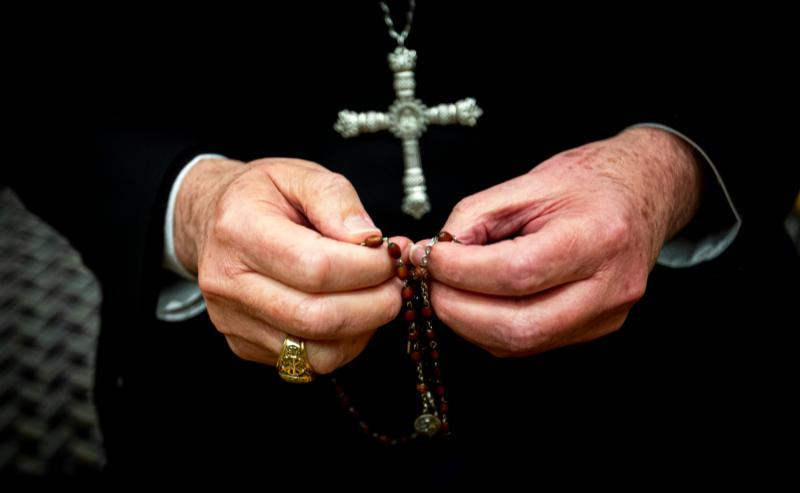 Los Angeles Archbishop Jose H. Gomez holds his rosary Nov. 10, 2019, in a Baltimore hotel where he was attending the U.S. bishops' fall general assembly