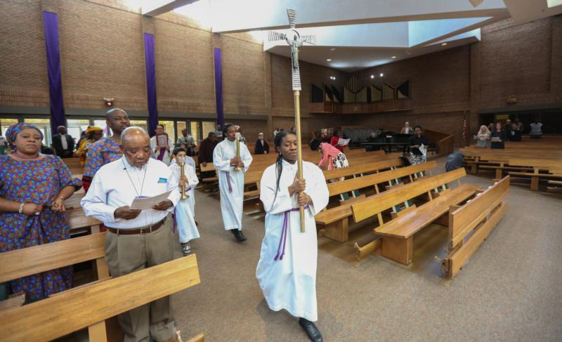 Sunday Mass at St. Alphonsus Church in Brooklyn Center, Minn., is sparsely attended March 15, 2020, due to concerns about spreading the coronavirus.