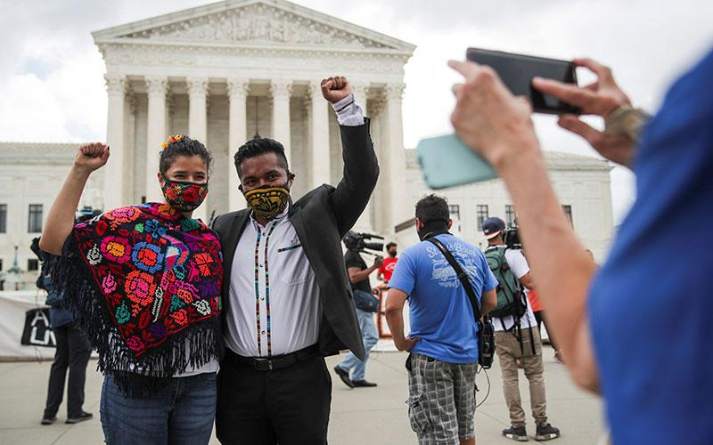 Gabrielle Betances and her husband, Luis Aguilar, a DACA recipient from Mexico, pose for a picture near the U.S. Supreme Court building in Washington June 18, 2020.