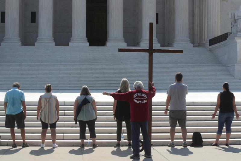 Demonstrators in Washington hold a large cross outside the U.S. Supreme Court July 8, 2020.