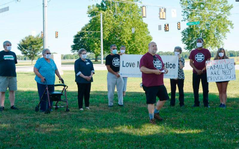 Abraham Bonowitz, co-director of Death Penalty Action, speaks during the organization's news conference outside the Federal Correctional Complex in Terre Haute, Ind., July 13, 2020.