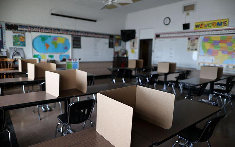 Social-distancing dividers for students at St. Benedict School in Montebello, Calif., are seen July 14, 2020.