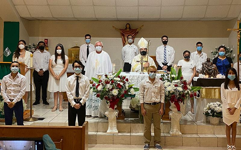 Bishop Daniel E. Flores of Brownsville, Texas, poses for a group photo July 26, 2020, after confirmations at San Felipe de Jesus Parish.