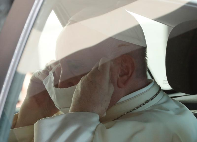 Pope Francis puts on a protective face mask as he enters the car after leading his weekly general audience at the Vatican Sept. 9, 2020