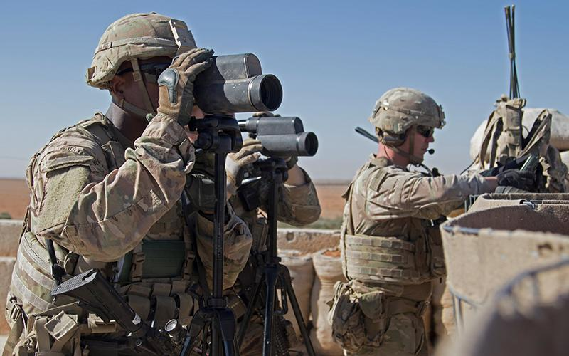 U.S. soldiers surveil the area during a combined joint patrol Nov. 1, 2018, in Manbij, Syria.
