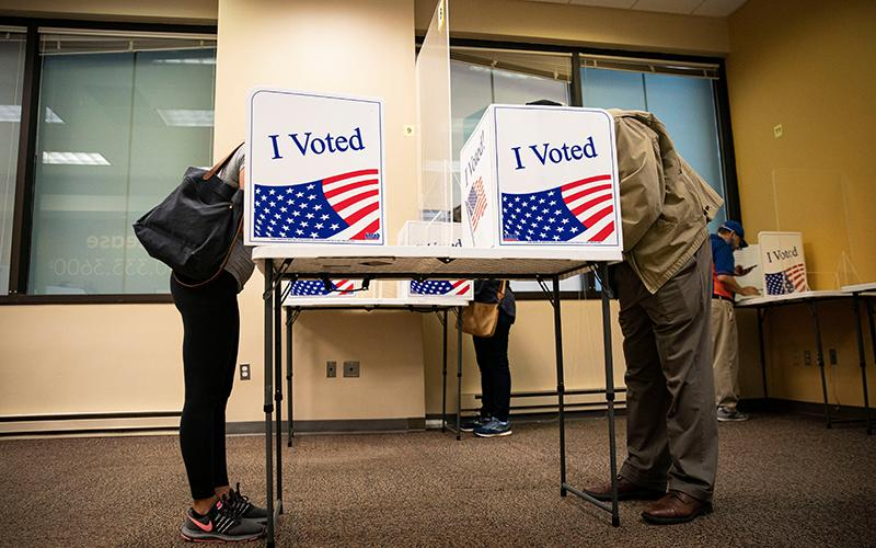 People fill out their ballots at an early voting site in Arlington, Va., Sept. 18, 2020.