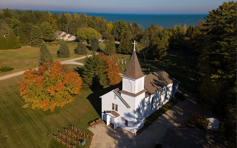 St. Michael Church in Jacksonport, Wis., and Lake Michigan are pictured in an aerial photo.