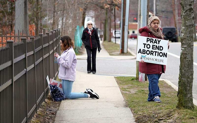 Pro-life advocates participate in a 40 Days for Life vigil near the entrance to a Planned Parenthood center in Smithtown, N.Y., March 19, 2020.