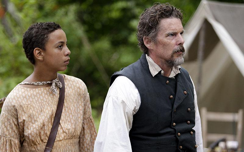 """Joshua Caleb Johnson and Ethan Hawke star in a scene from the seven-episode television series """"The Good Lord Bird,"""" premiering 9-10 p.m. EDT Oct. 4, 2020, on Showtime."""