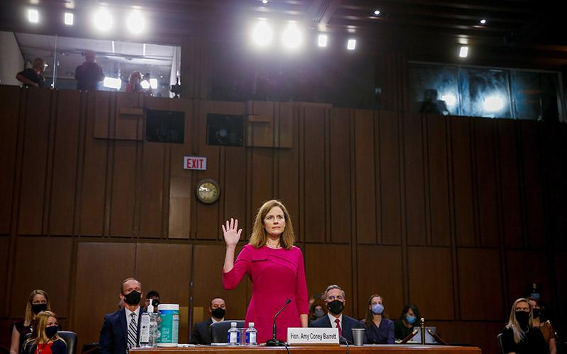 Judge Amy Coney Barrett of the U.S. Court of Appeals for the 7th Circuit, President Donald Trump's nominee for the U.S. Supreme Court, is sworn in during a confirmation hearing before the Senate Judiciary Committee on Capitol Hill in Washington Oct. 12, 2020.