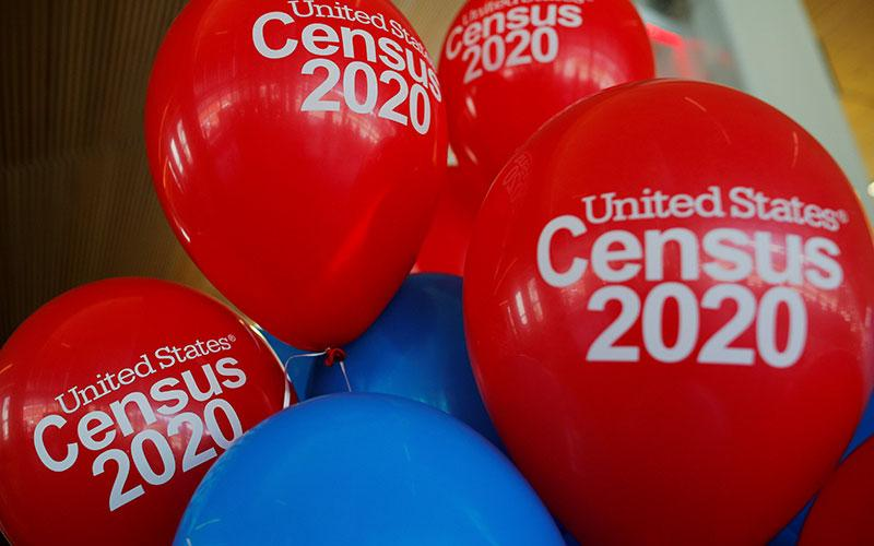 Balloons are seen at an April 1, 2019, event for community activists and local government leaders marking the one-year-out launch of the 2020 census efforts in Boston.