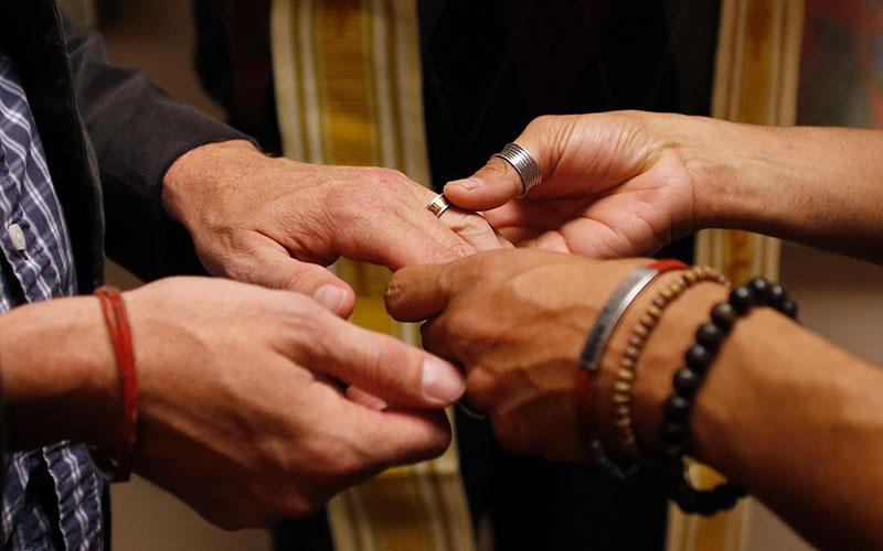 A same-sex couple is pictured in a file photo exchanging rings during a ceremony in Salt Lake City.