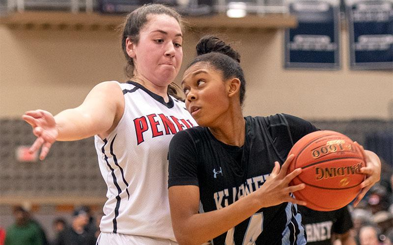 Bishop Kearney's Camille Wright drives the ball past Penfield's Jessica Renere in the Section 5 Class AA girls' basketball championship against Penfield March 6 at Gates Chili High School.