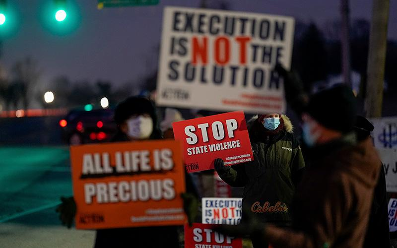 Demonstrators in in Terre Haute, Ind., gather to protest the execution of Lisa Montgomery Jan. 12, 2021.