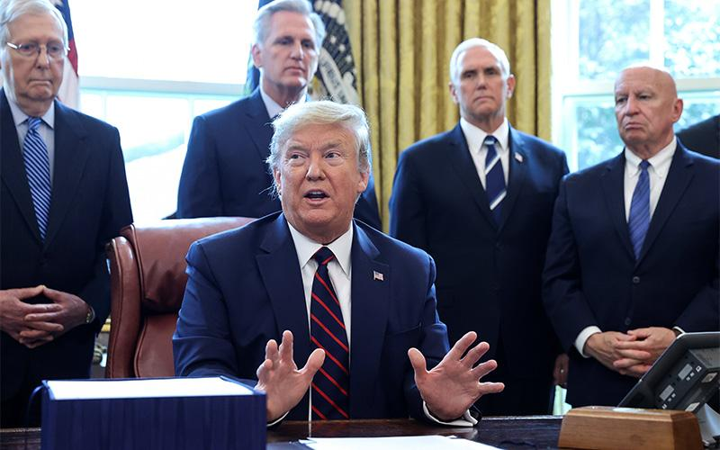 President Donald Trump is seen March 27, 2020, before a bill signing at the White House in Washington.