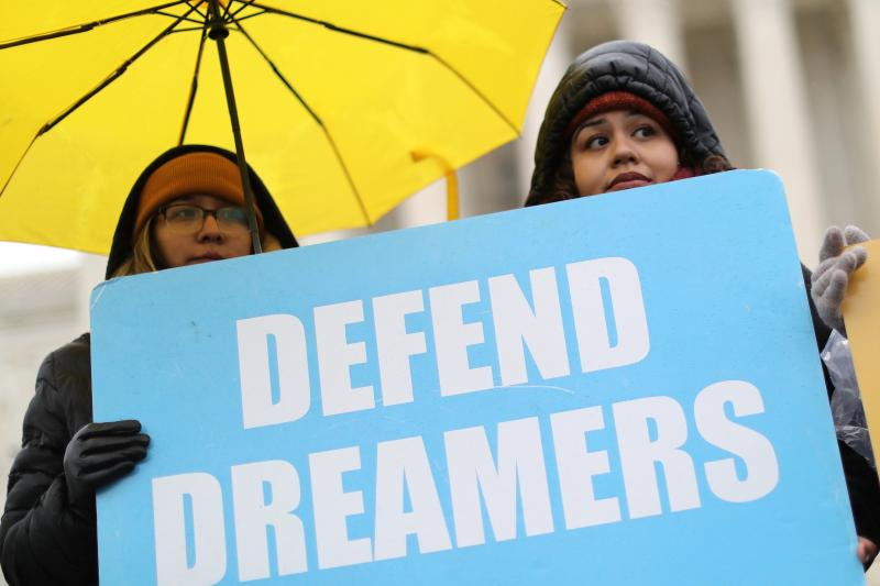 Demonstrators in support of DACA hold signs outside the U.S. Supreme Court in Washington Nov. 12, 2019.