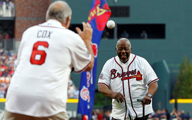Atlanta Braves legend Hank Aaron throws the ceremonial first pitch to former manager Bobby Cox April 14, 2017, prior to the first game at SunTrust Park.