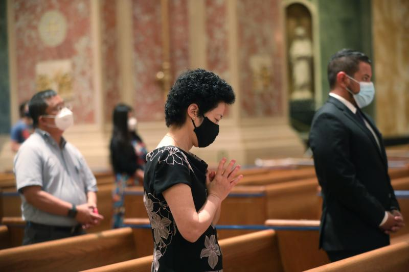 People pray during an Aug. 28, 2020, Mass at the Cathedral of St. Matthew the Apostle in Washington.