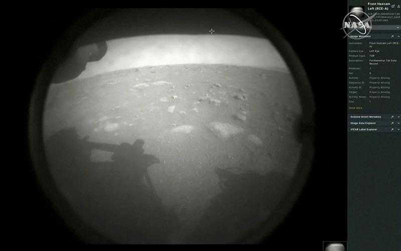 """The first images arrive moments after NASA's """"Perseverance"""" Mars rover spacecraft successfully touched down on Mars, in this image from video at NASA's Jet Propulsion Laboratory in Pasadena, Calif., Feb. 18, 2021."""