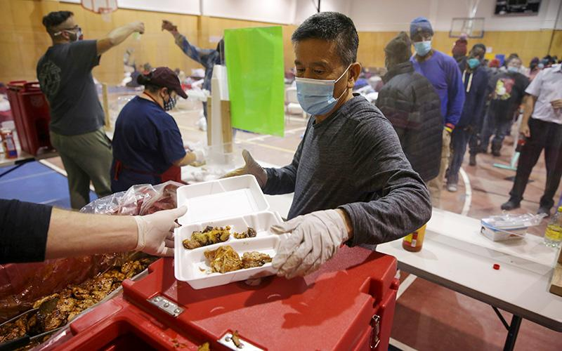 Volunteers hand out meals at a Salvation Army facility in Plano, Texas, Feb. 18, 2021, after winter weather caused electricity blackouts.