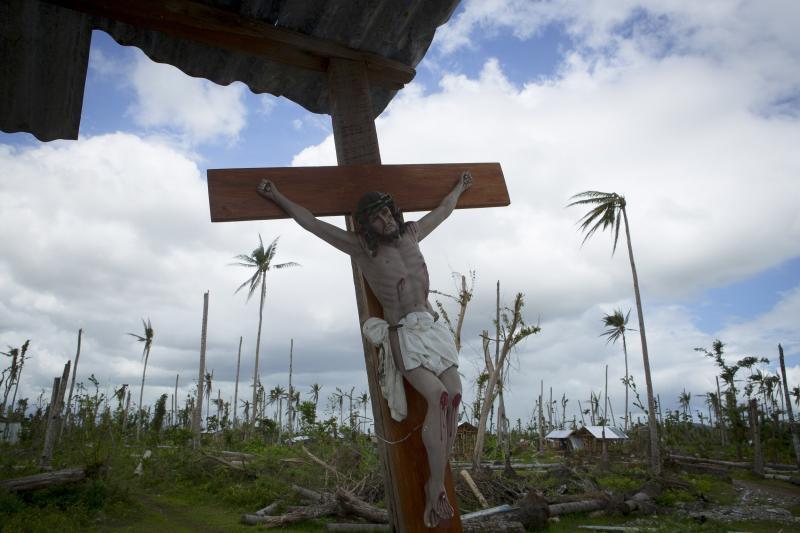 A crucifix is displayed in Barangay Cabarasan Guti, a community in Tanauan, Philippines, Feb. 6, 2014.