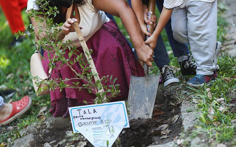 Relatives of disappeared people in in Buenos Aires, Argentina, plant a tree as a homage March 24, 2021, the 45th anniversary of the 1976 military coup at the former Naval Mechanics School building which was used as a torture center