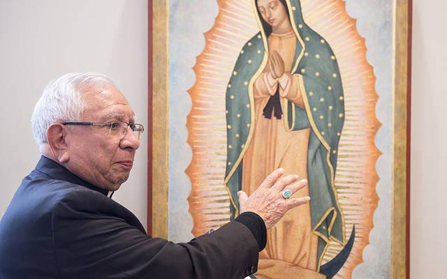 <p>Bishop Emeritus Ricardo Ramirez of Las Cruces, N.M., talks about the icon of Our Lady of Guadalupe that was dedicated during a ceremony at St. John Fisher College Dec. 10. (Courier photo by John Haeger)  </p>